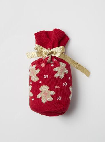 Gingerbread man socks in a bag