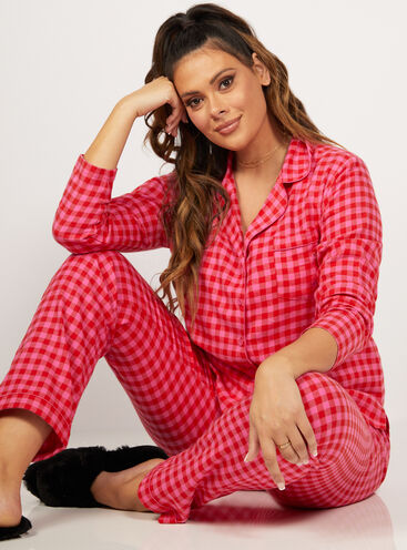 Red and pink gingham pyjamas in a bag
