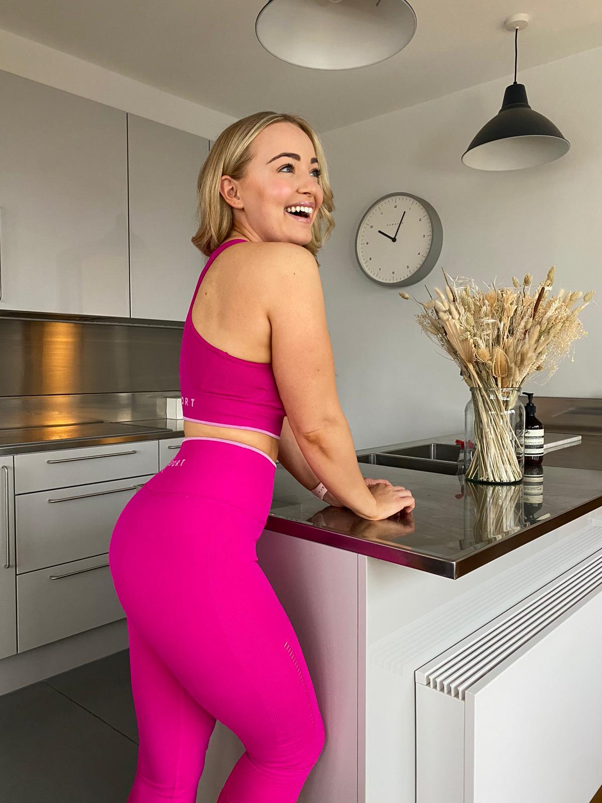 women wearing pink gym leggings