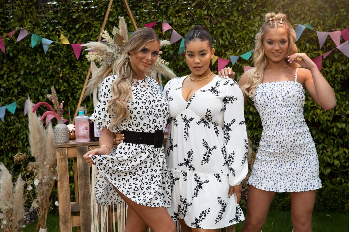 Three women wearing summer dresses