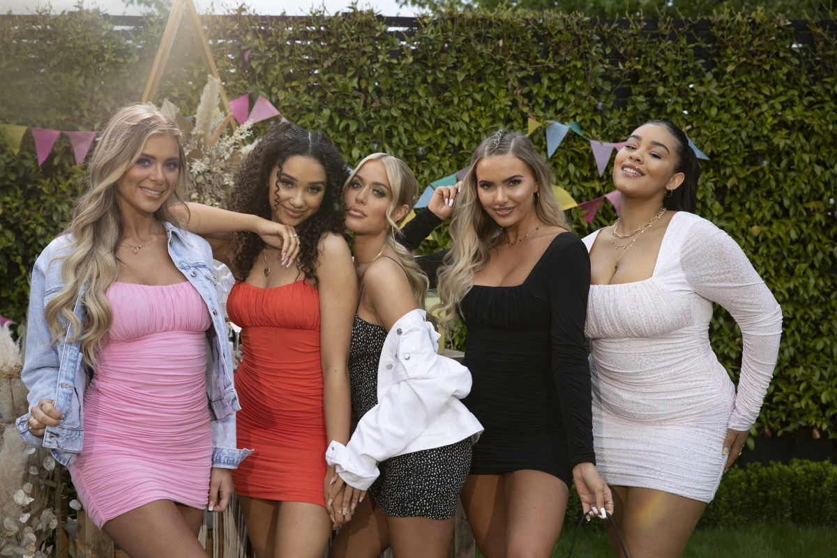 Group of women wearing bodycon dresses