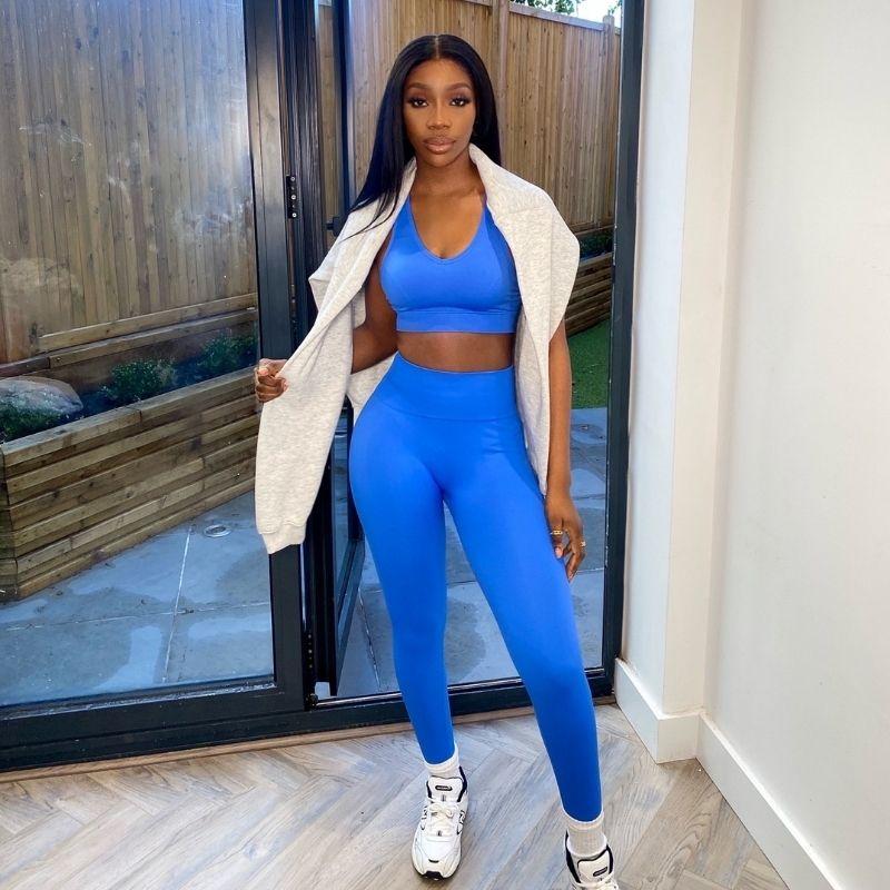 woman wearing blue gym leggings